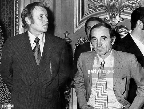 Picture taken in July 1971 in Rome of US actor Rod Steiger and French singer and actor Charles Aznavour arriving at the Quirinale palace to attend...