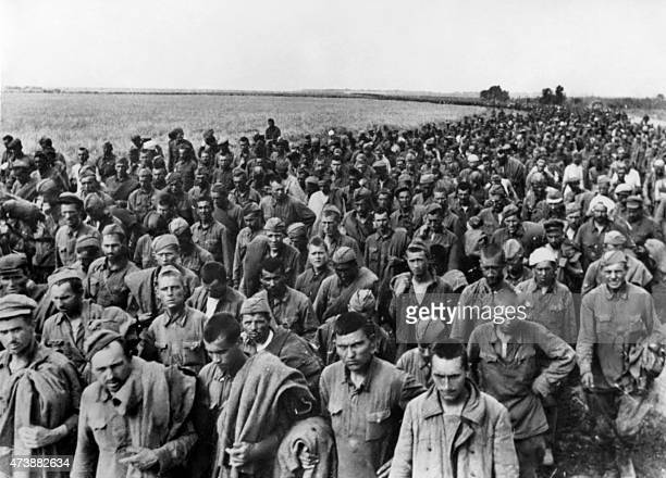 A picture taken in June 1942 during World War II shows Soviet prisoners of war captured by nazi tanks in the south of Ukraine walking to a...