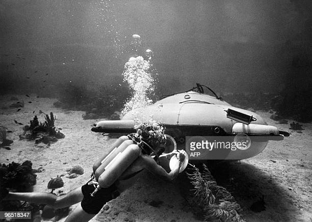 Picture taken in June 1963 of French explorer and oceanographer JacquesYves Cousteau near his 'diving saucer' during an undersea exploration in the...