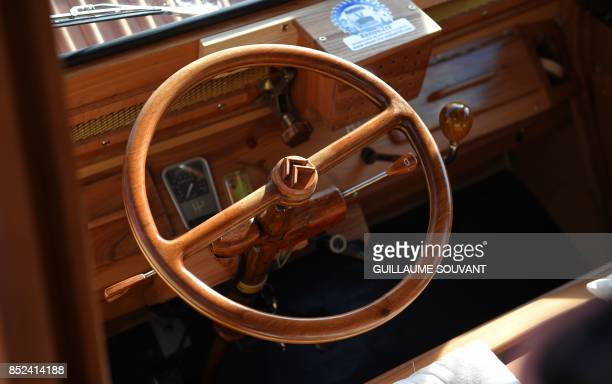 A picture taken in Loches Central France on September 23 2017 shows the steering wheel of the wooden 2CV Citroen car built by French cabinetmaker...
