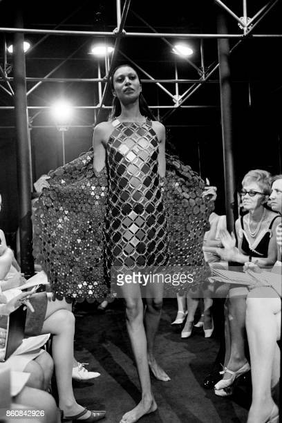 Picture taken in March 1968 of a model presenting a metal dress by Spanish designer Paco Rabanne during a fashion show in Paris / AFP PHOTO /