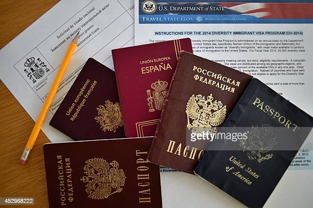 A picture taken in Moscow on July 31 shows Russian US Spanish an British passports laying together with visa application forms A new law goes into...