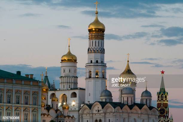 A picture taken in Moscow on May 6 2016 shows the Great Kremlin Palace and The Ivan the Great Bell Tower the tallest tower of the Moscow Kremlin...