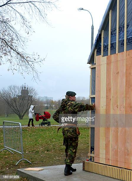 A picture taken in Moscow's in Kolomenskoye Park on October 18 shows a soldier of the Netherlands 101st Engineer Battalion working to create a...