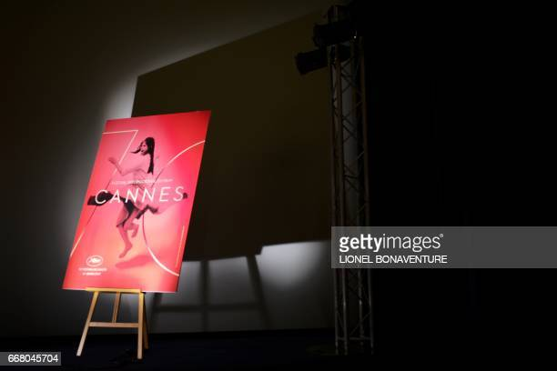 A picture taken in Paris on April 13 2017 shows the official poster of the 70th International Cannes Film Festival during a press conference to...