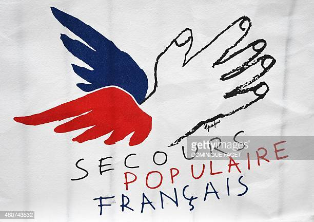 Picture taken in Paris on December 21 2014 shows the logo of the French charity organisation Secours Populaire Francais AFP PHOTO / DOMINIQUE FAGET