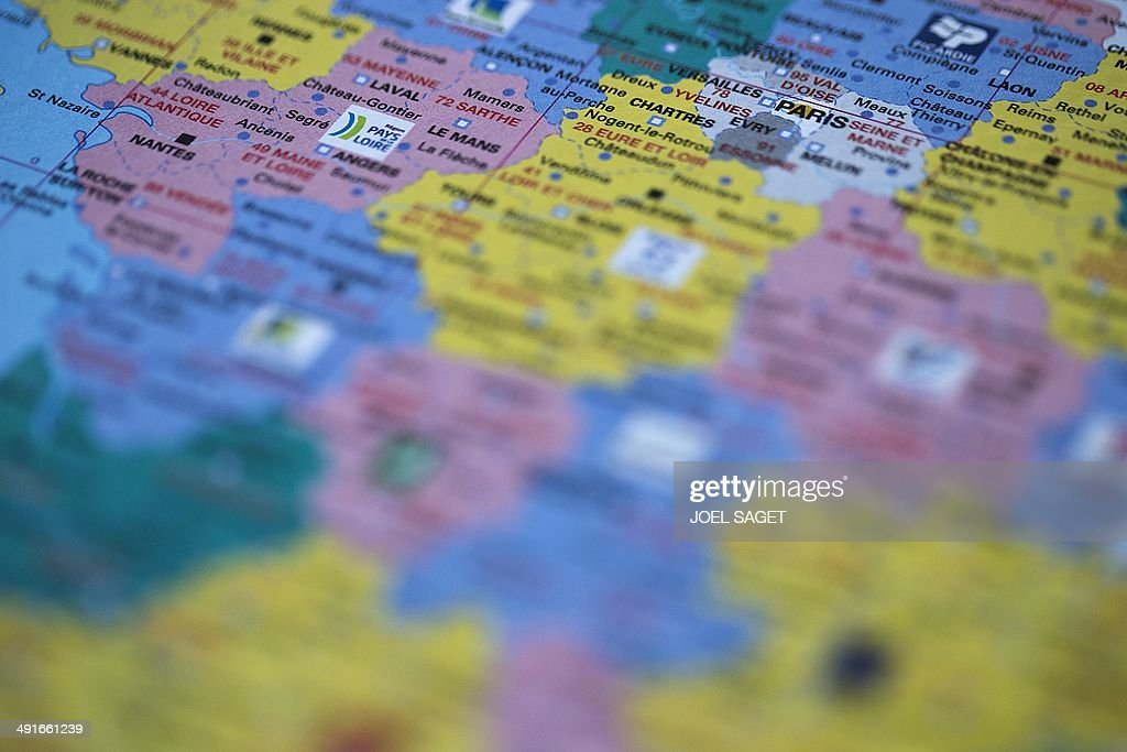 A picture taken in Paris on May 17, 2014 shows a close-up view of central France's administrative regions on a French map, with the logo of the Pays de Loire and Paris regions.