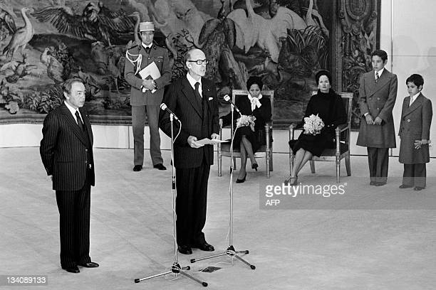 A picture taken in Paris on November 22 1976 shows King Hassan II of Morocco with French President Valery Giscard d'Estaing giving a speech as...