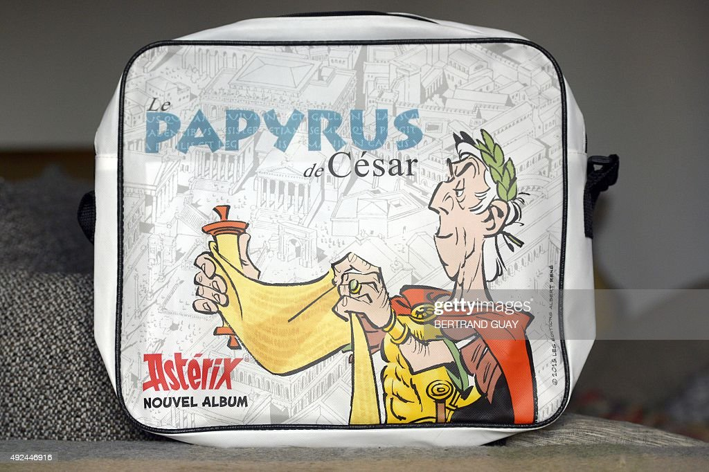A picture taken in Paris on October 12 shows a picture of Didier Conrad placed on a bag showing the title of the last Asterix album 'Le Papyrus de...