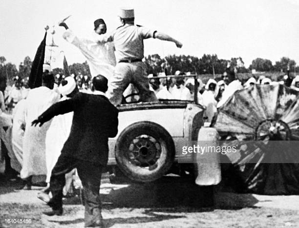 A picture taken in Rabah on September 11 1953 shows Allal ibn Abdallah fighting with an officer trying to overcome him after he attacked Moroccan...