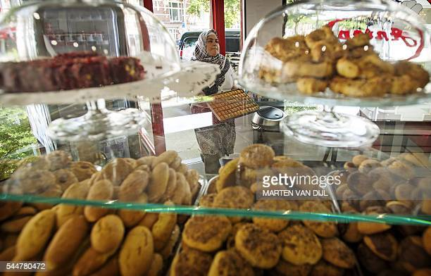 A picture taken in Rotterdam on July 4 shows Turkish sweets at the backery Antep in preparation for Eid alFitr the celebration which marks the ending...