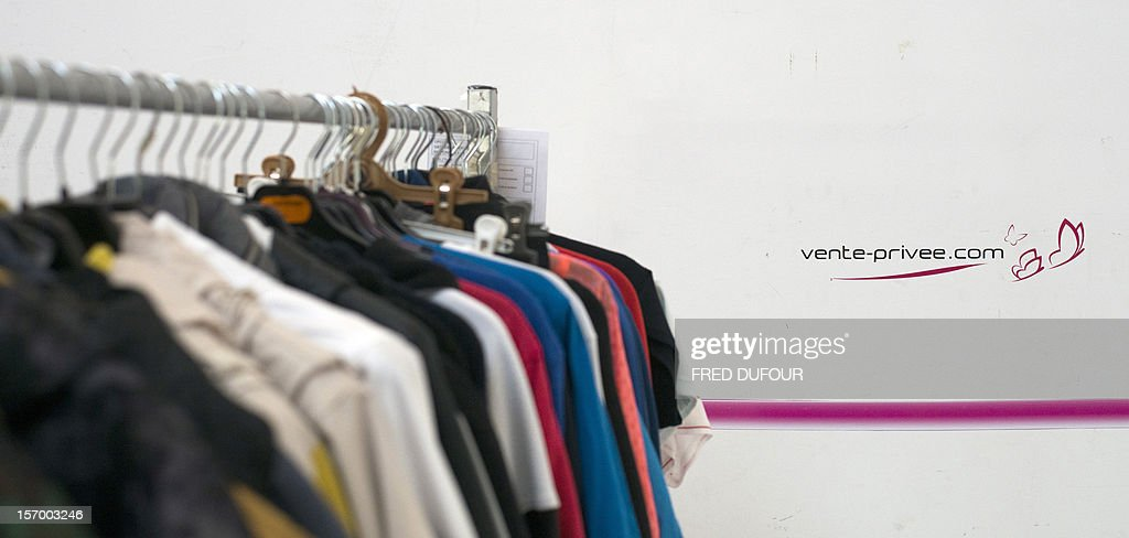 Picture taken in Saint-Denis, north of Paris, shows clothes on a rack at the headquarters of vente-privee.com, on November 27, 2012, ahead of the Christmas and new Year celebrations. The vente-privee.com storage facilities celebrates its 10th anniversary. AFP PHOTO / FRED DUFOUR