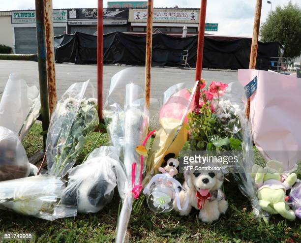 A picture taken in SeptSorts 55km east of Paris on August 15 2017 shows flowers laid out next to a pizza restaurant covered by a black tarpaulin in...