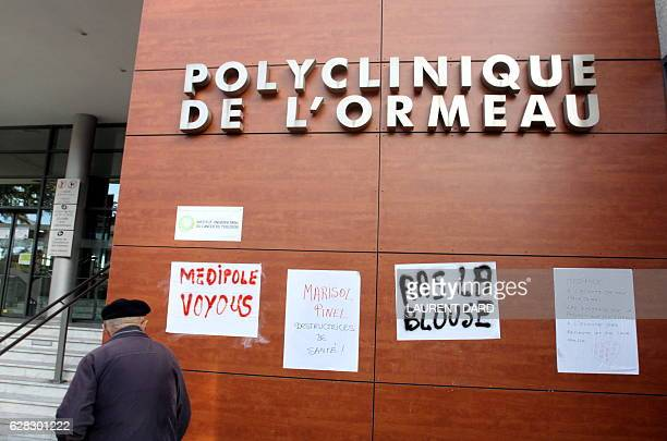 A picture taken in Tarbes on December 7 2016 shows placards on the facade of the Polyclinique de L'Ormeau during a strike by employees of the clinic...