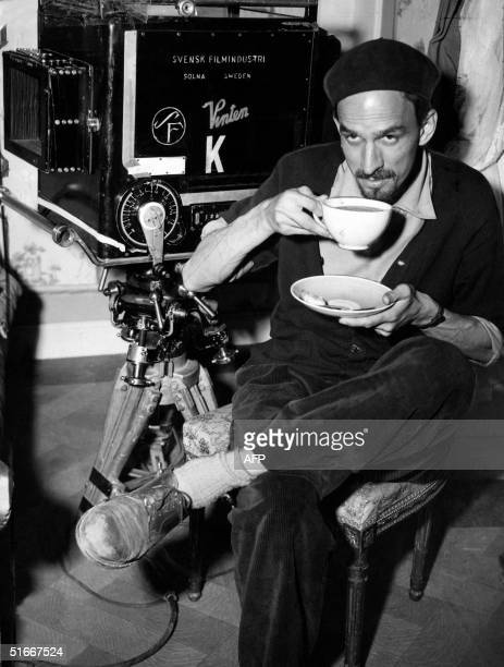 Picture taken in the 1960s in Sweden shows legendary Swedish filmmaker and theater director Ingmar Bergman drinking a cup of tea while shooting a...
