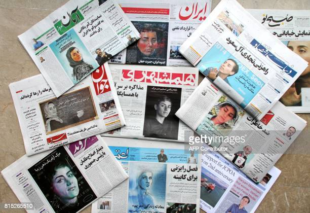 A picture taken in the capital Tehran on July 16 2017 shows the front pages of Iranian newspapers bearing portraits of the top female scientist...