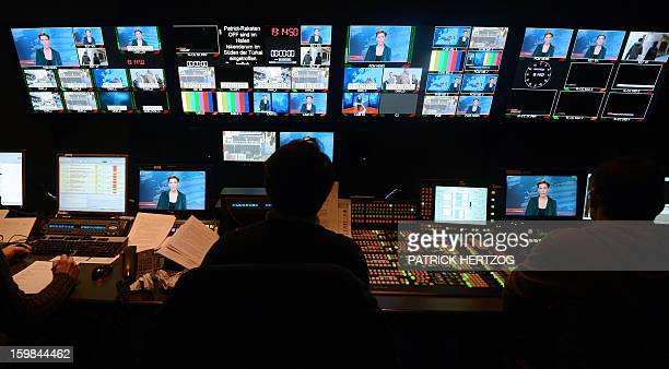Picture taken in the control room of the FrancoGerman TV network Arte in Strasbourg eastern France on January 21 2013 during the broadcast news as...