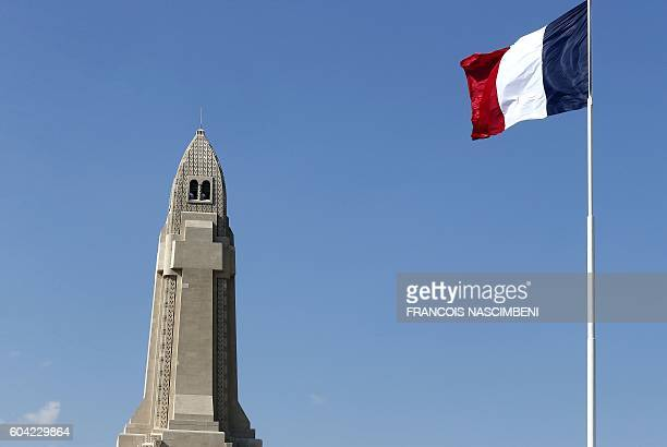 A picture taken in the Douaumont Ossuary near Verdun northeastern France on September 13 2016 shows the the Ossuary building and a French flag during...