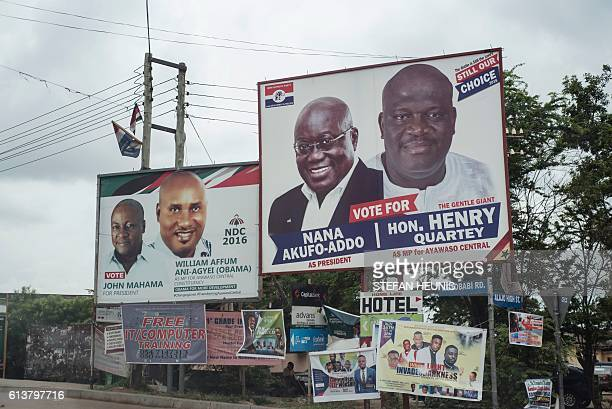 A picture taken in the streets of Accra in Ghana on October 8 2016 shows campaign billboards of Ghana's two main political parties running in this...