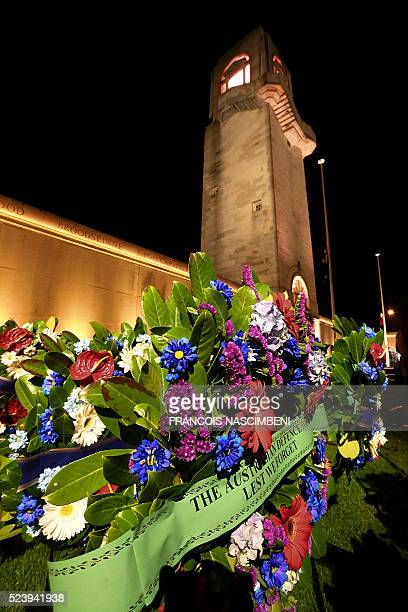 A picture taken in VillersBretonneux on April 25 2016 shows a spray of flowers at the Australian Memorial of the World War I battle of the Somme...