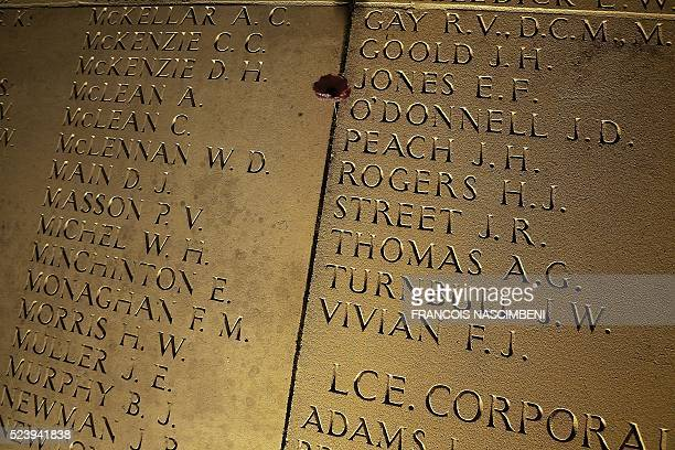A picture taken in VillersBretonneux on April 25 2016 shows soldiers name written on the wall of the Australian Memorial of the World War I battle of...