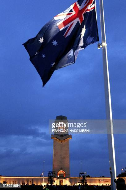A picture taken in VillersBretonneux on April 25 2016 shows the Australian National flag fluttering at the Australian Memorial of the World War I...
