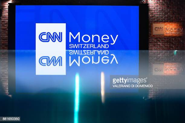 A picture taken in Zurich on November 29 2017 shows CNN Money Switzerland logo during a press conference at their television studios The...