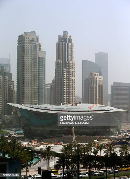 A picture taken June 20 2016 shows the Dubai Opera House under construction in downtown Dubai Dubai opens its opera house on August 31 2016 in a bid...