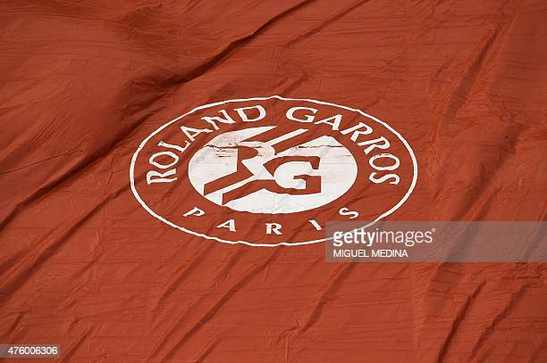 A picture taken June 5 2015 shows the logo of Roland Garros after the court was covered during the men's semifinal match Great Britain's Andy Murray...