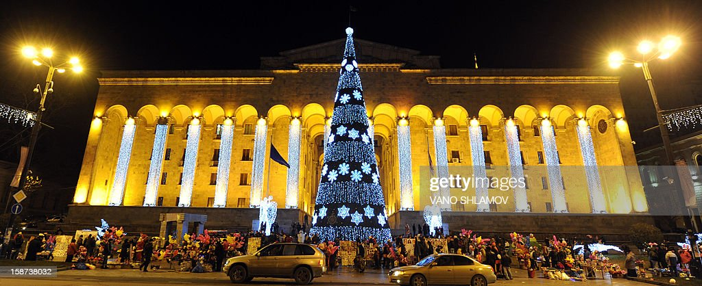 A picture taken late on December 26, 2012, shows a New Year tree rising in front of the Georgia's parliament old building in central Tbilisi.