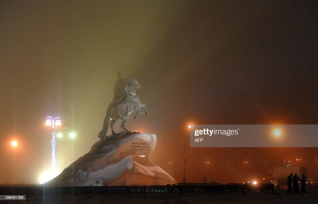 A picture taken late on January 13, 2013, shows one of the Saint-Petersburg's landmarks, the equestrian statue of Peter the Great known as 'The Bronze Horseman,' rising amidst the fog. The temperatures in the Russia's second city of Saint-Petersburg reached today -2 C (27 F). AFP PHOTO / OLGA MALTSEVA