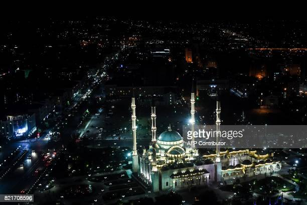 TOPSHOT A picture taken late on July 24 2017 shows the Heart of Chechnya mosque and the avenue named after Russian President Vladimir Putin in...