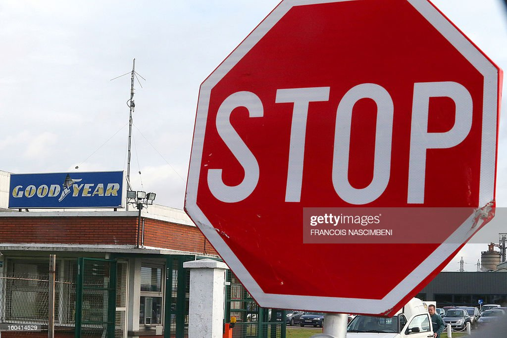 Picture taken of a stop road sign in front of the entrance of the US tyre manufacturer Goodyear plant in Amiens, northern France, on January 31, 2013. Executives at a Goodyear tyre plant in Amiens presented today a plan to close the site, which employs 1,173 workers. 'Closing the factory is the only option after five years of unsuccessful negotiations,' said a statement, which added that the plan had been presented to a works committee and would serve as the basis for further consultations with workers' representatives.