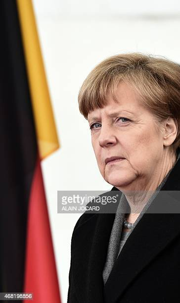 Picture taken of German chancellor Angela Merkel waiting for French President on March 31 2015 in front of the Chancellery in Berlin Merkel and...