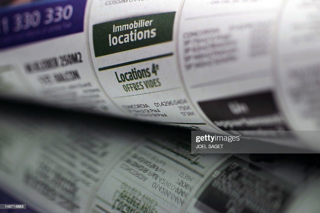 Picture taken of real estate classifieds on a newspaper, on June 4, 2012, in Paris.