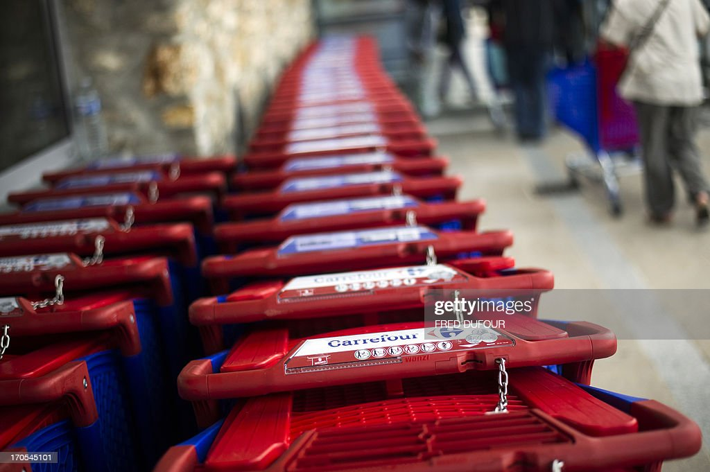 Picture taken of shopping carts in a Carrefour supermarket, on June 14, 2013 in Sainte-Geneviève-des-Bois, outside Paris. Installed in Sainte-Geneviève-des-Bois since fifty years, on June 15, 1963, this supermarket is the first of French giant retailer Carrefour group, but also the first in France.