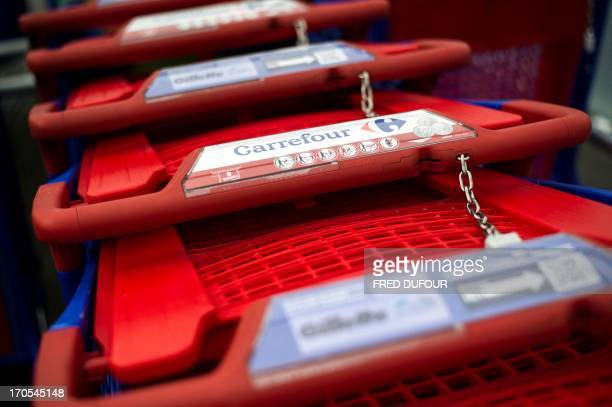 Picture taken of shopping carts in a Carrefour supermarket on June 14 2013 in SainteGenevièvedesBois outside Paris Installed in...