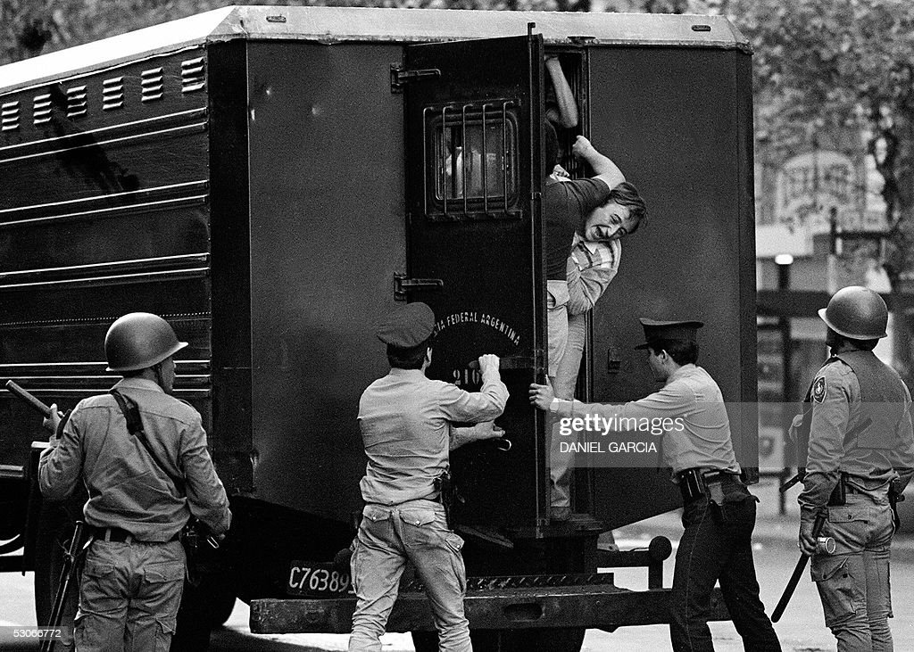 Picture taken on 30 March 1982 in Buenos Aires of arrested citizens being loaded onto a police van by special forces of the Federal Police during a...