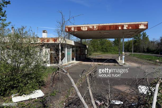 A picture taken on April 10 near Roquefort southwestern France shows a forsaken gas station on a secondary road AFP PHOTO / NICOLAS TUCAT / AFP PHOTO...