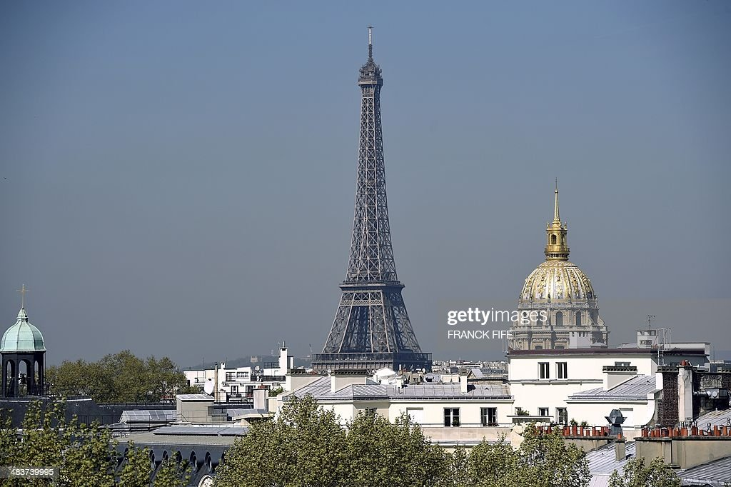 A picture taken on April 10, 2013, shows a view of the Eiffel Tower from the suite 'La Parisienne' at the luxury hotel 'Lutetia' in Paris. The hotel, built in 1910 by French architects Louis-Charles Boileau and Henri Tauzin, will close its doors on April 14, 2014, prior to a total renovation. Throughout the years, various celebrities stayed at the 'Lutetia', such as French author and winner of the Nobel Prize in Literature in 1947 Andre Gide, American-born French actress Josephine Baker and French General Charles de Gaulle on the occasion of his wedding night. AFP PHOTO / FRANCK FIFE