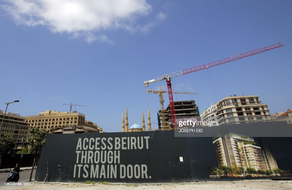 A picture taken on April 12, 2013 in Beirut shows a giant banner protecting a construction site in an area of the city center that was destroyed during the 15-year Lebanese civil war.