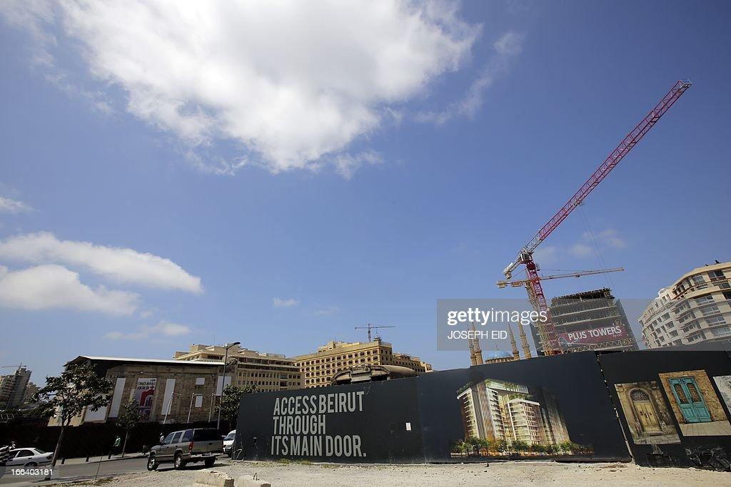 A picture taken on April 12, 2013 in Beirut shows a giant banner protecting a construction site in an area of the city center that was destroyed during the 15-year Lebanese civil war. AFP PHOTO/JOSEPH EID
