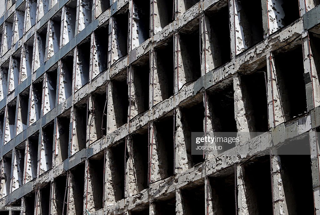 A picture taken on April 12, 2013 shows a bullet riddled building dating back to the Lebanese Civil War that stretched from 1975 to 1990, located in which used to be a demarcation line that split Beirut into two parts.