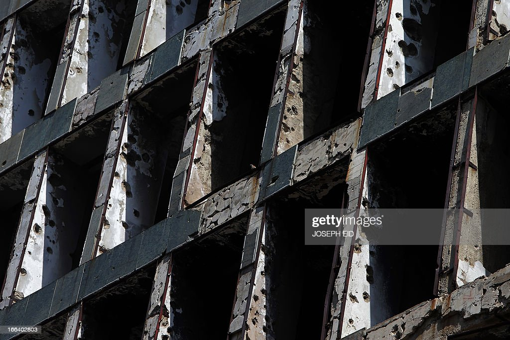 A picture taken on April 12, 2013 shows a bullet riddled building dating back to the Lebanese Civil War that stretched from 1975 to 1990, located in which used to be a demarcation line that split Beirut into two parts. AFP PHOTO/JOSEPH EID