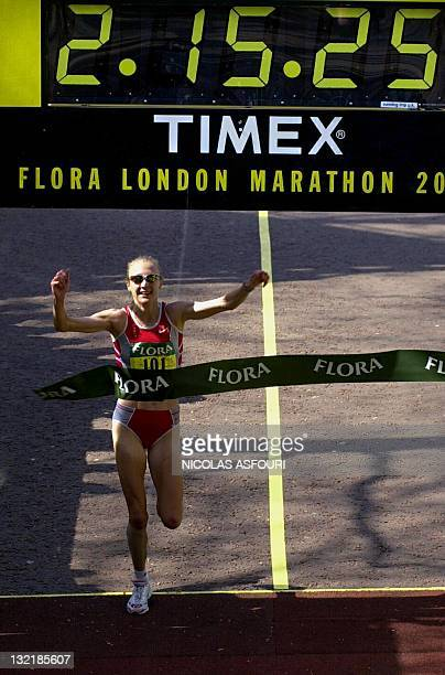 A picture taken on April 13 2003 shows British Paula Radcliffe breaking her own world record in 2 hours 15 minutes and 25 seconds as she crosses the...