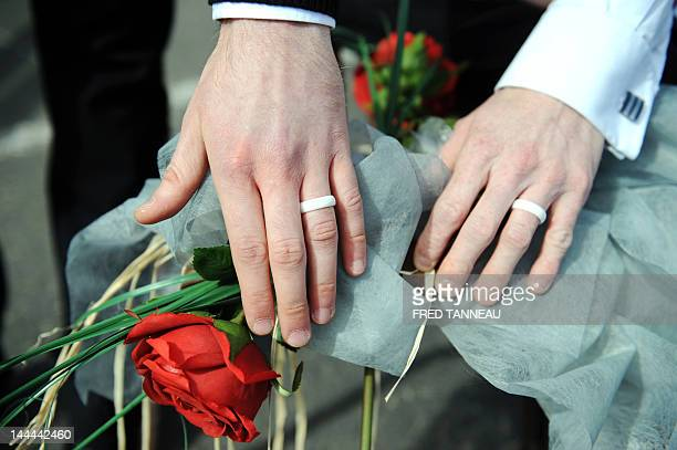 A picture taken on April 15 2012 shows wedding rings of David Humily and Julien Abernot after they got symbolically married by a member of the 'Paris...