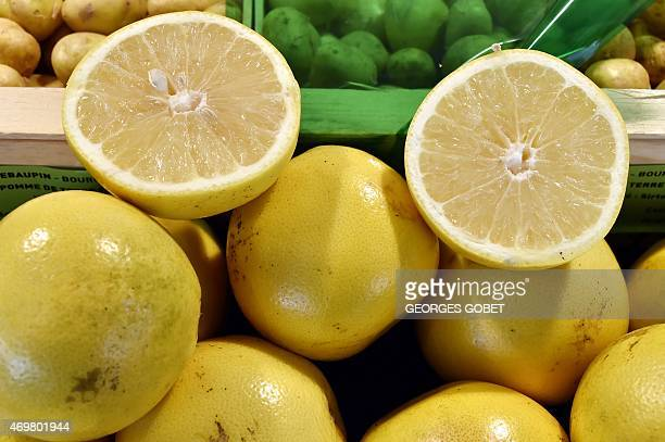 A picture taken on April 15 2015 shows grapefruits on display at the Talensac market in central Nantes western France /AFP PHOTO GEORGES GOBET