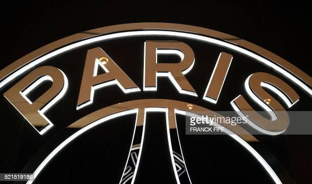 A picture taken on April 15 2016 shows part of the logo of French Ligue 1 football team Paris SaintGermain at Parc des Princes stadium in Paris / AFP...