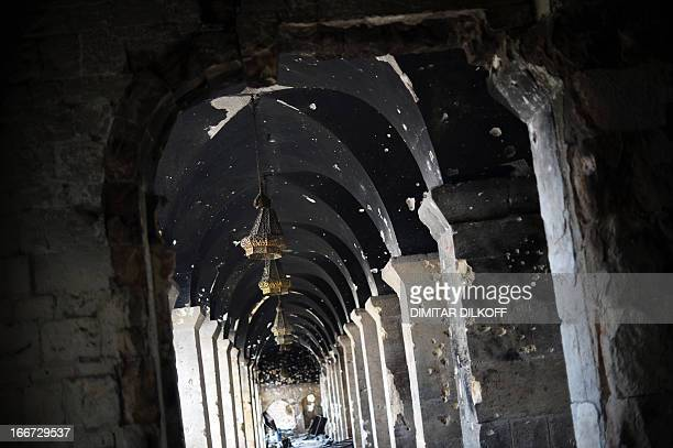 A picture taken on April 16 2013 shows part of the Umayyad Mosque complex riddled with bullet holes in the old part of Syria's northern city of...