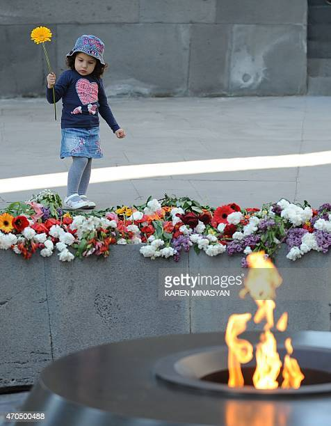 A picture taken on April 16 2015 shows a girl visiting the Tsitsernakaberd Armenian Genocide Memorial in Yerevan Armenians prepare to commemorate on...